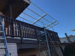 Cleas glass patio cover with white frame