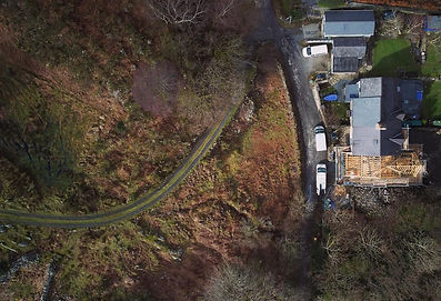 Aerial photo Frondeg Uchaf timber frame extension Anglesey North Wales Architect Architecture