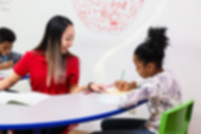 Instructor helping girl student.jpg