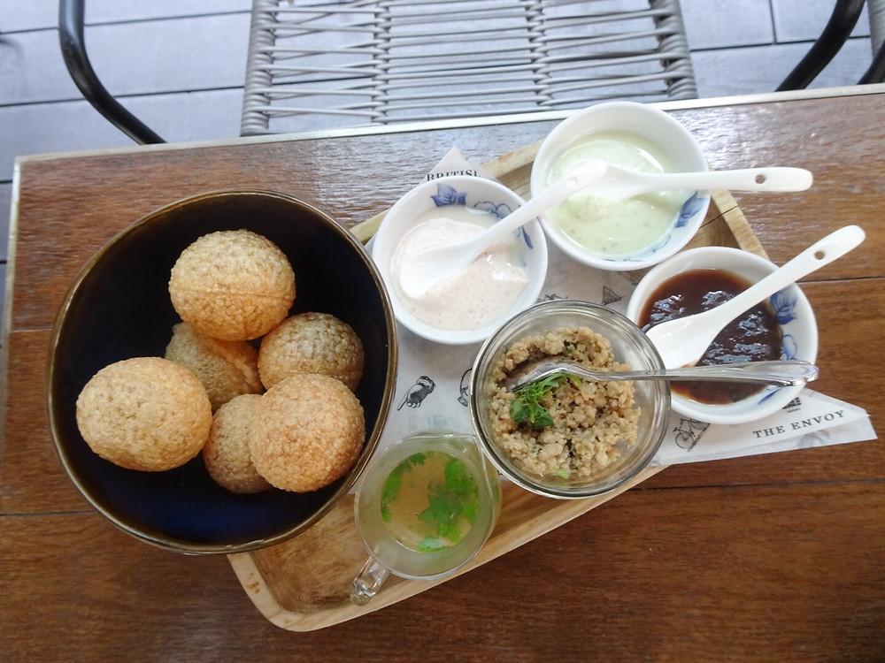 Food at The Envoy restaurant and bar at The Pottinger Hotel Hong Kong