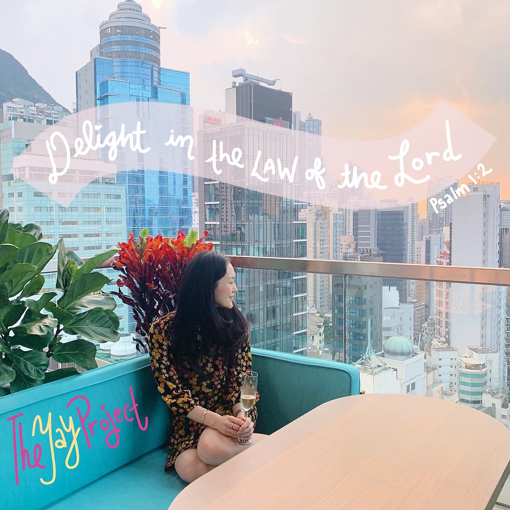 Jenni Lien of The Yay Project looking at the Hong Kong skyline at sunset