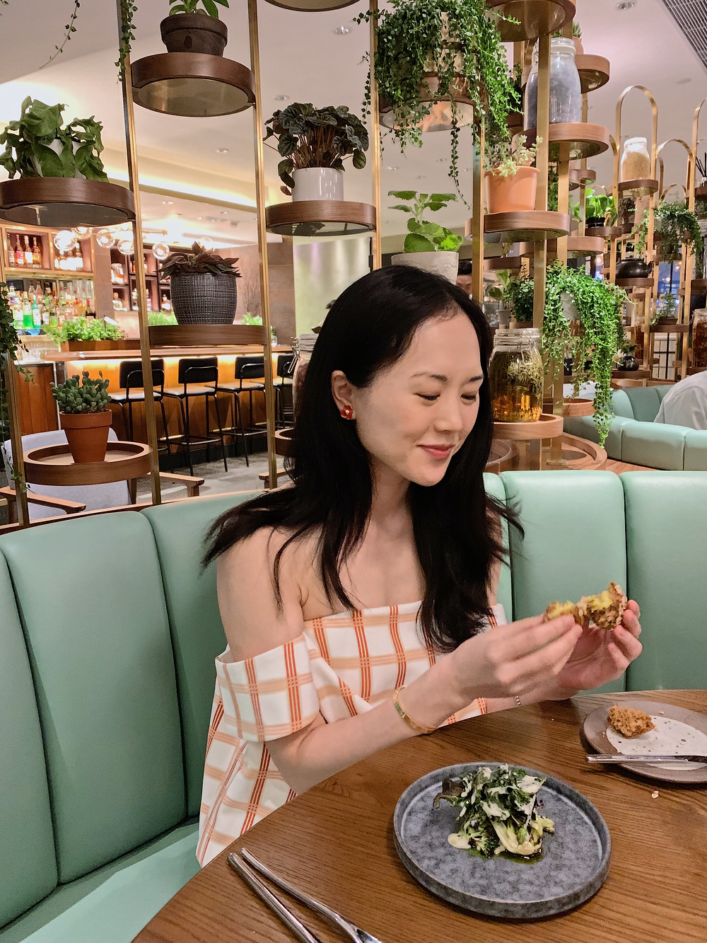 Jenni Lien of The Yay Project eating bread at Roganic in Hong Kong