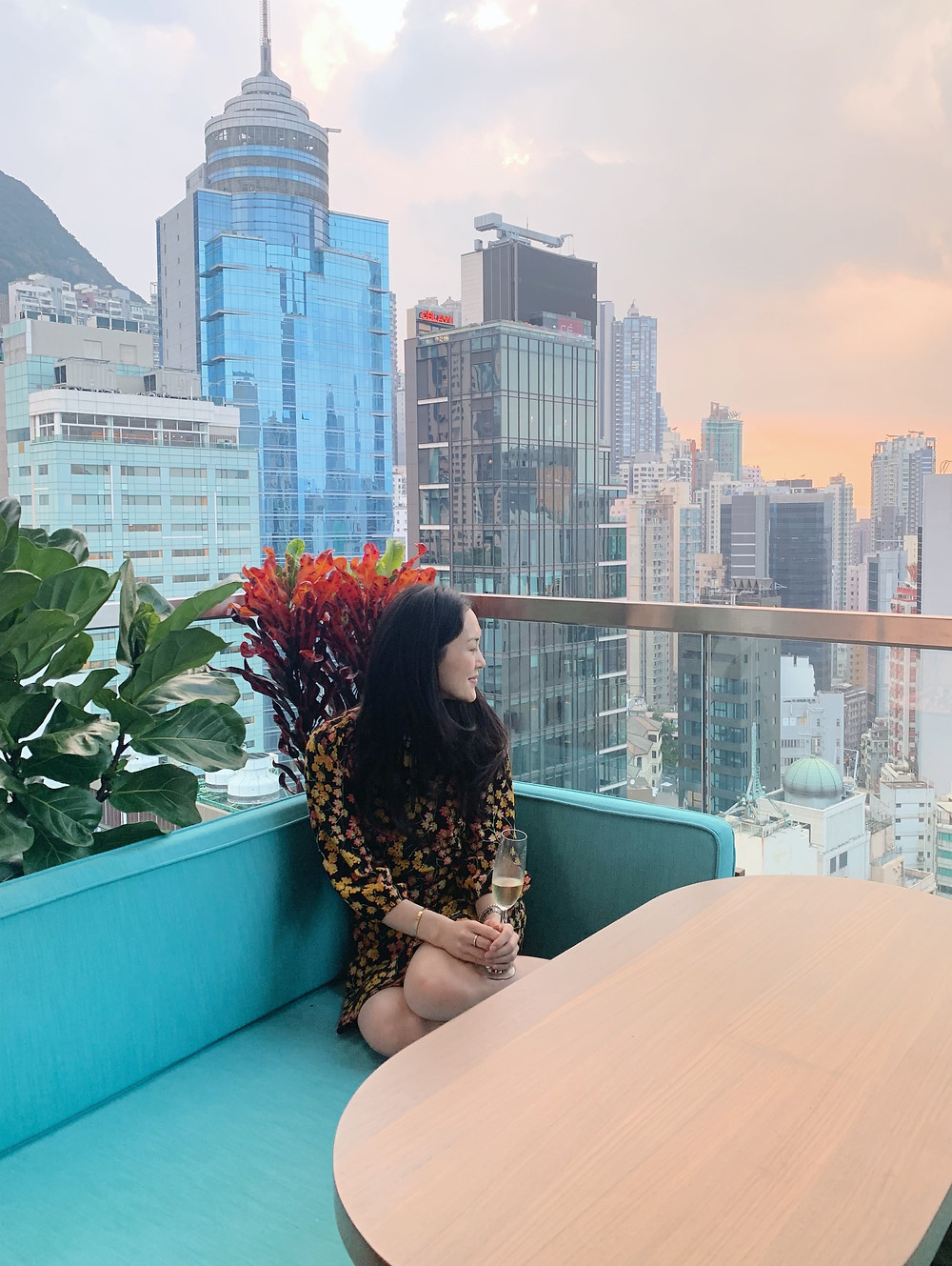 Jenni Lien blogger on a patio at sunset