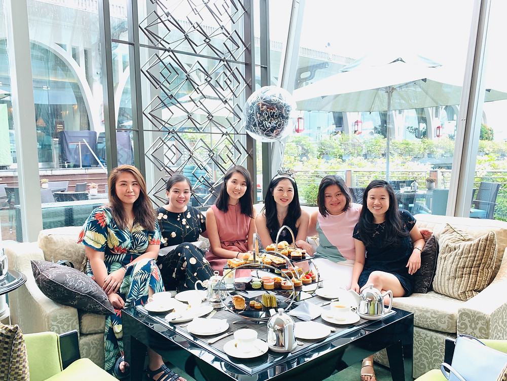 Friends at afternoon tea at the Fullerton Bay Hotel Singapore