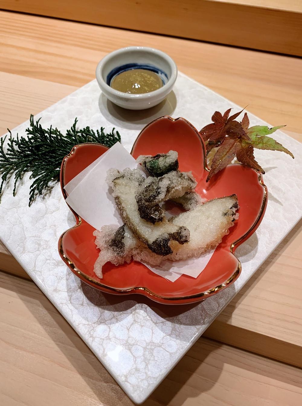Abalone at Kakure Japanese restaurant at Landmark in Hong Kong