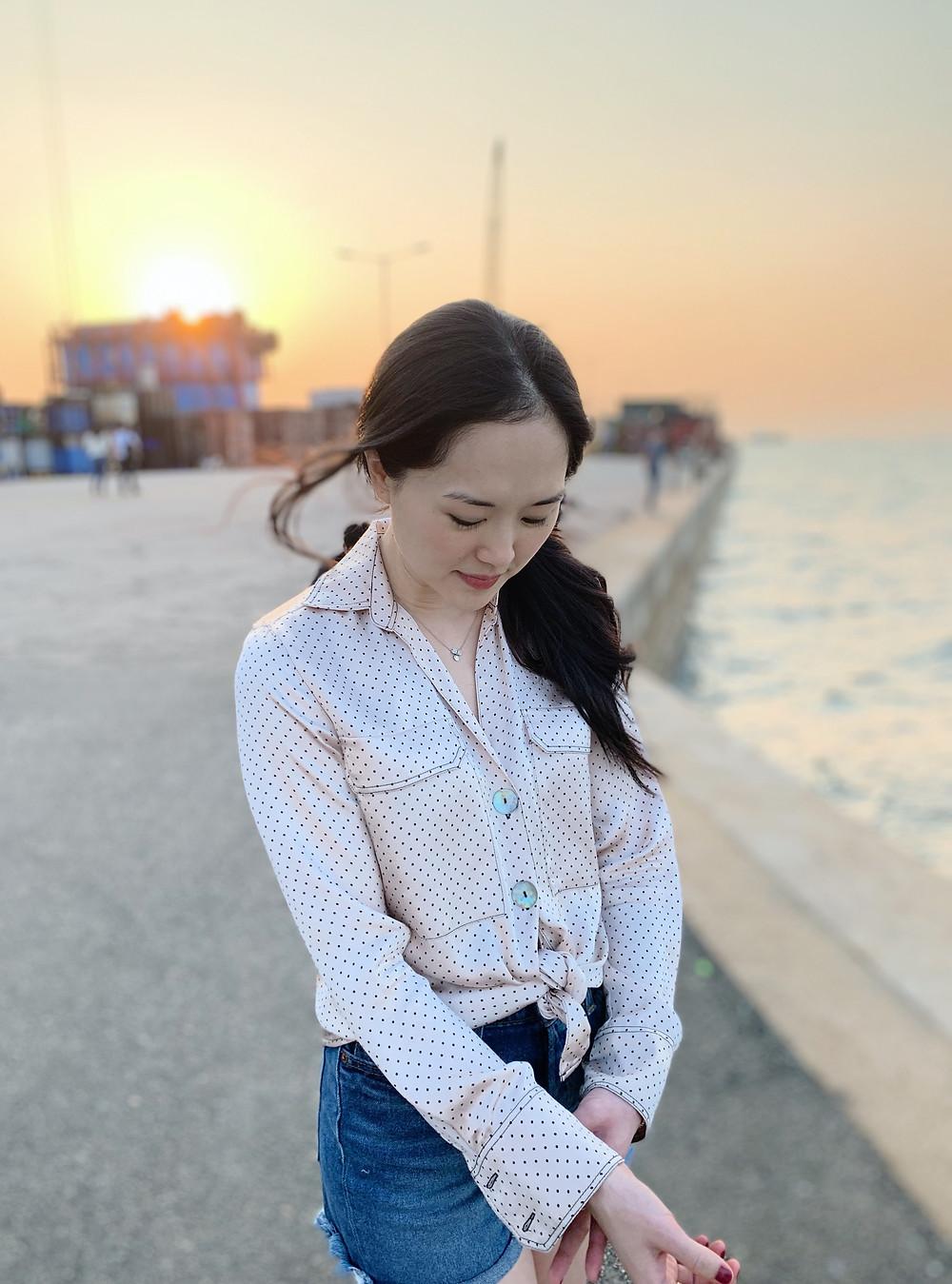 Jenni Lien blogger at a sunset pier