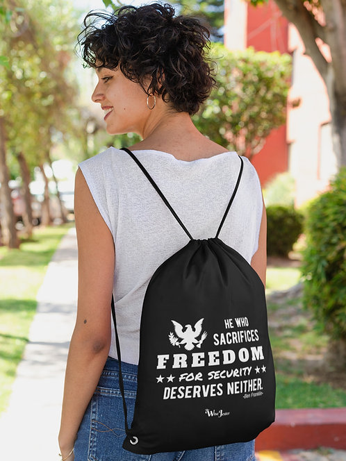He who sacrifices freedom for security deserves neither. Woman wearing black drawstring back with zipper pocket