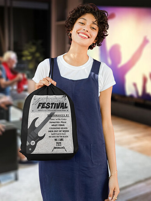 Stay At Home Festival 2020 Band - woman holding black drawstring bag with zipper pocket while watching concert on TV