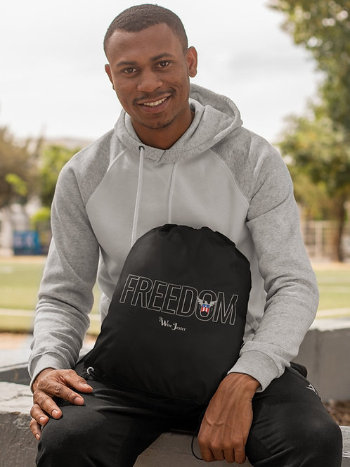 Freedom - man holding black drawstring bag with zipper pocket