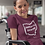 Impeach DeWine (Ohio Governor) Woman in wheelchair wearing maroon unisex short sleeve crew neck t-shirt