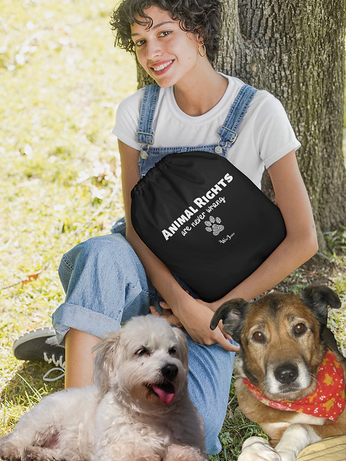 Animal Rights Are Never Wrong - woman holding black drawstring bag with zipper pocket while sitting with 2 dogs
