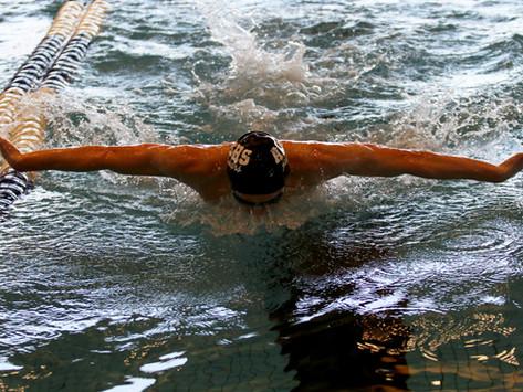 Kruegers impress on swim team