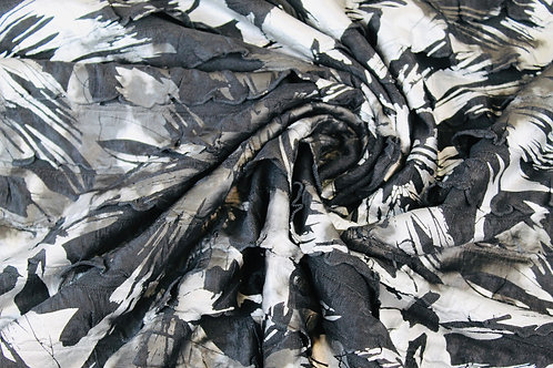 Polyester Viscose Mix Fabric. Painted Silver/Black Ruffles on a Black Background