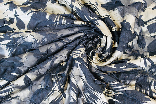 Polyester Viscose Mix Fabric. Painted Gold & Black Ruffles on a Black Background