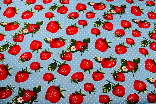 100% Cotton Fabric. Red Strawberries & White Florals on a Sky Blue Background.