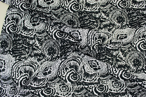 Linen Cotton Mix Fabric. Black Floral Repeat Design on a White Background.