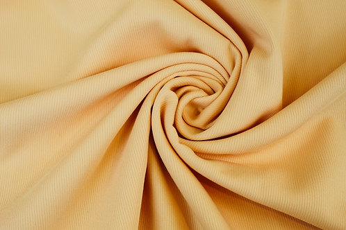 Polyester Viscose Mix Suiting Fabric in Soft Peach.