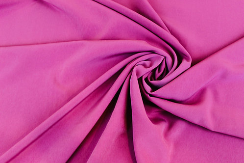 100% Polyester Fabric in Dusty Pink.