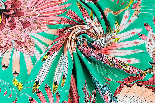 100% Viscose Fabric. Carnival Inspired Design with Pink, White & Gold Feathers.