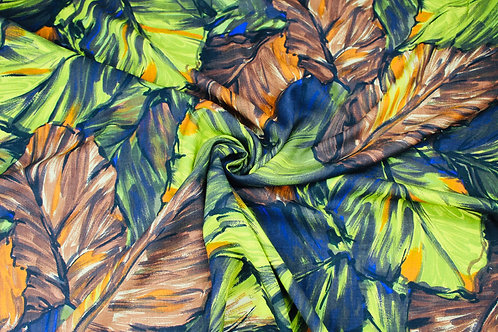 Poly Cotton Fabric. Striking Tropical Leaf Design in Browns, Oranges and Yellows