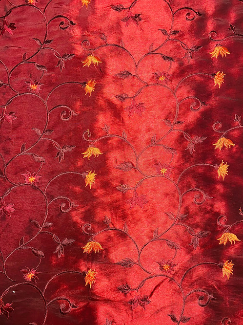 Polyester Satin Fabric. Delicate Floral Embroidery on a Red/Burgundy Background.