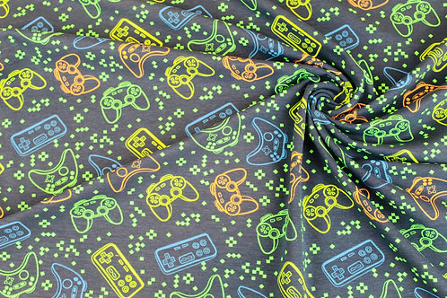 Cotton Jersey Stretch Fabric. Neon Game Controllers in Green, Blue & Yellow.
