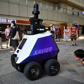 Singapura testa robôs para patrulhar ruas