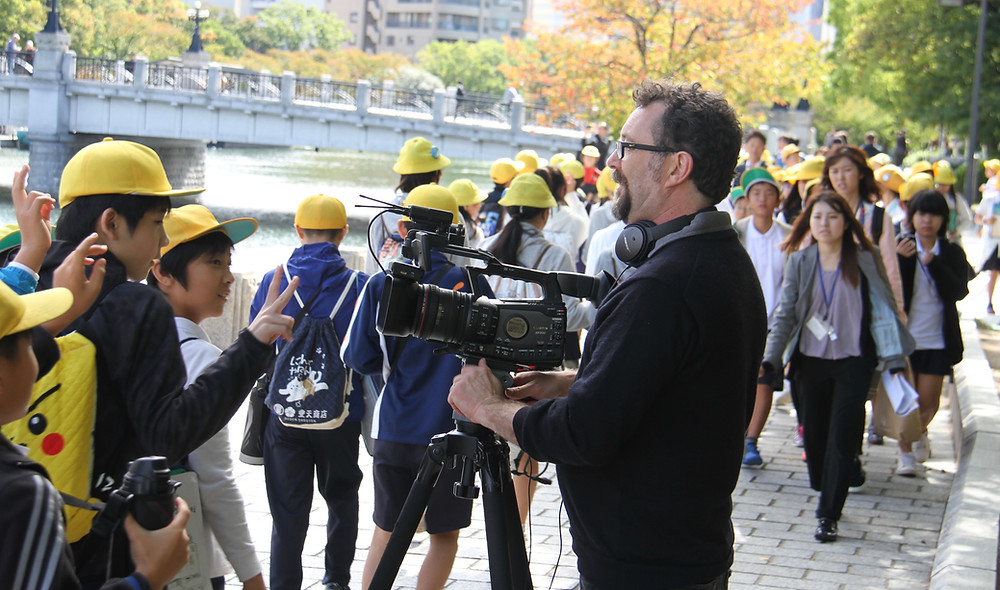 Filming in the Peace Park on school excursion day.
