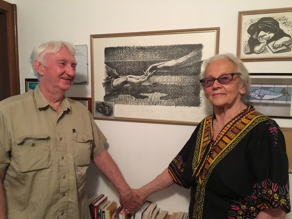 Halina and William Kelly with a Kelly print in the background.