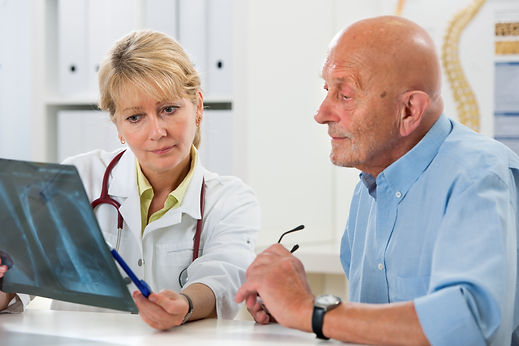 Doctor explaining x-ray results to senio