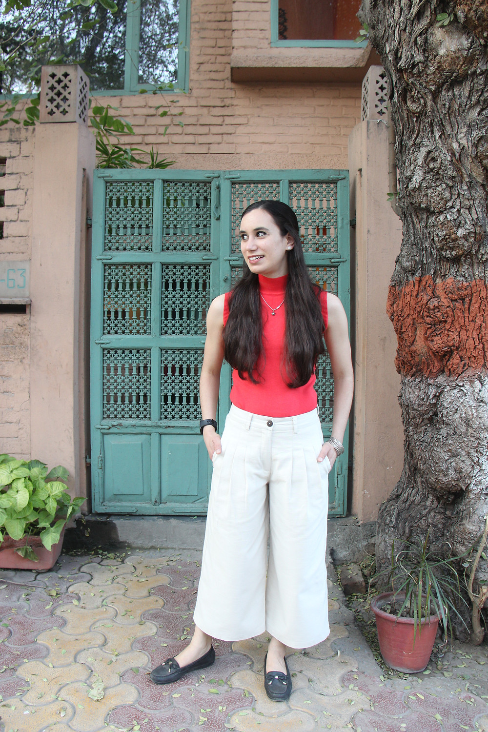 Comfortable flared palazzo pants in cream colour.