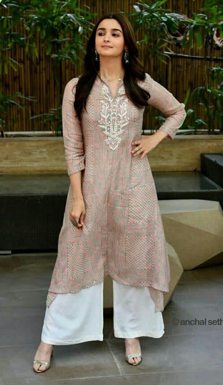 Alia Bhatt sporting a kurti with white Palazzo Pants.