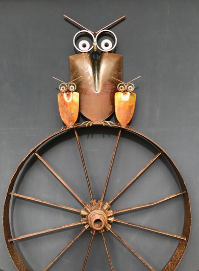 Owl Family On Antiqe Wagon Wheel
