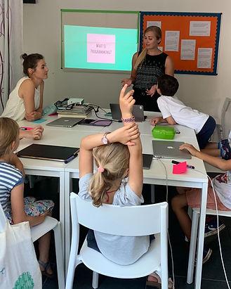 Children learning how to program