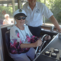 Ann Baldachino steering a boat on the No