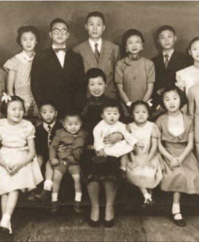 Already in Brazil, a first formal portrait of the Sieh Family complete with 13 children