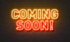 coming-soon-neon-sign-brick-wall-backgro