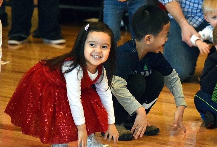 Kids participate in a Family Literacy Fiesta