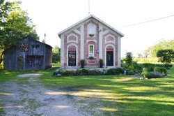 Front of schoolhouse and workshop