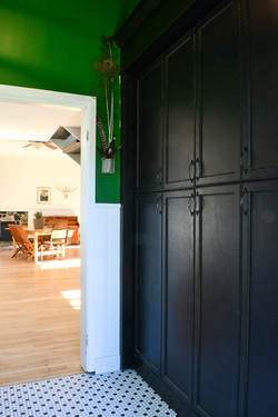 Large custom entryway cupboards