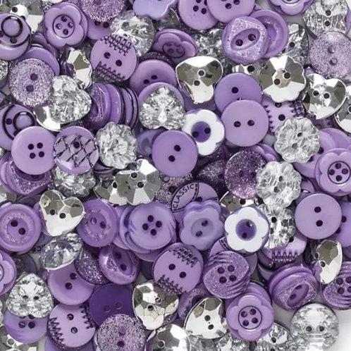 6 un botón lila aprox 12mm