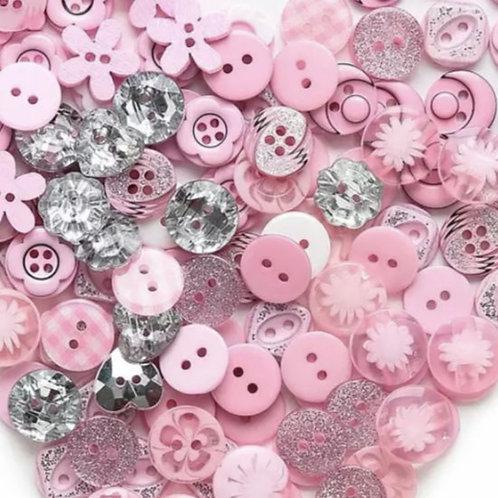 6 un botón rosado aprox 12mm