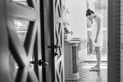 beautiful-upset-woman-in-towel-standing-
