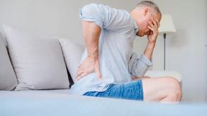 Quais são os sintomas de problemas na coluna?