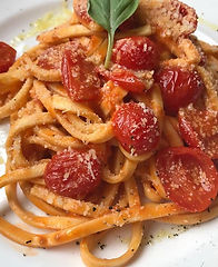Pasta with cherry tomatoes and basil