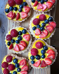 Italian custard tarts with  fresh berry topping
