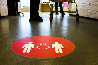 Red round sign printed on ground at supe
