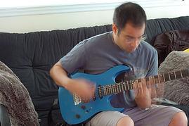 Raj and guitar.JPG