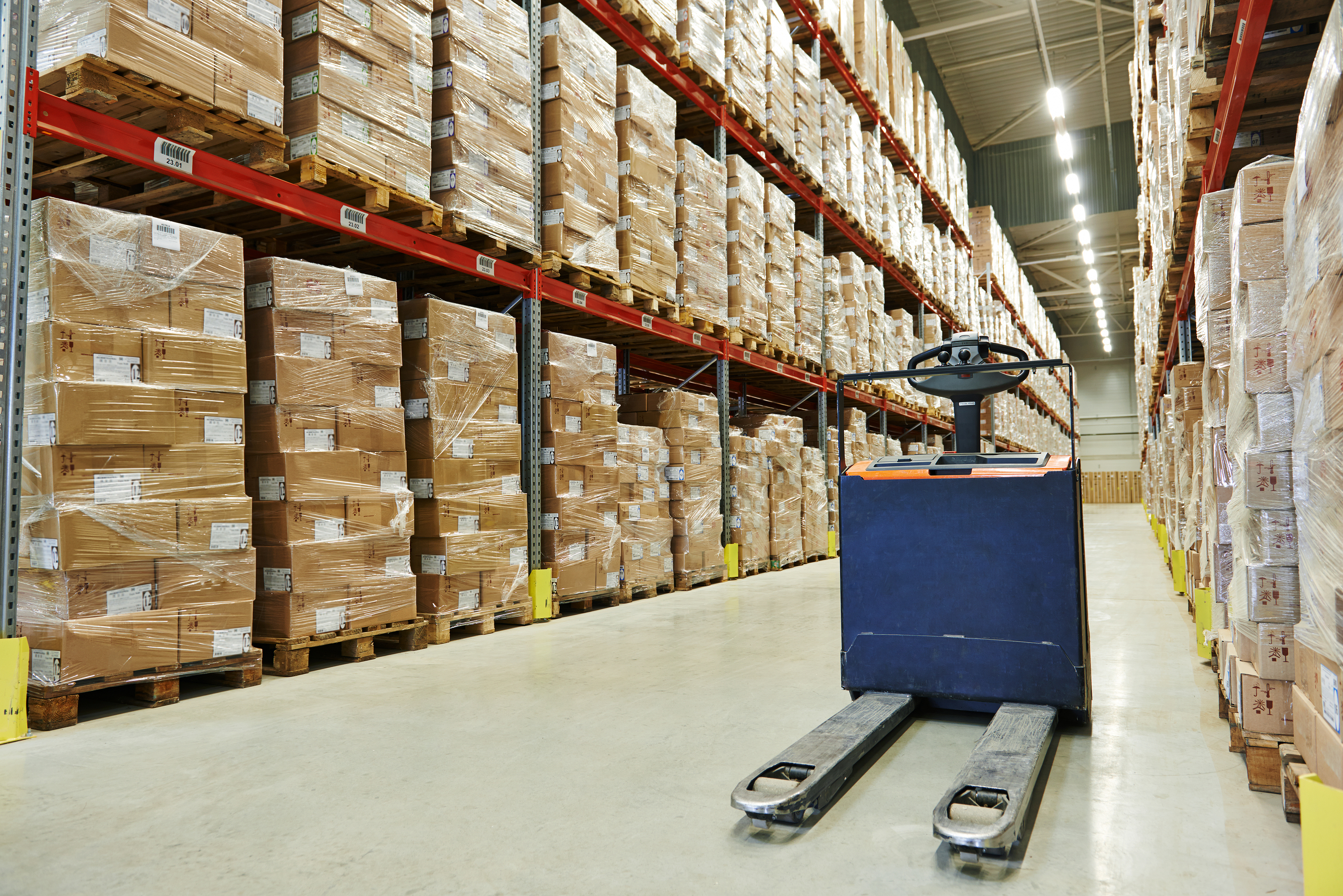 Manual forklift pallet stacker truck equipment at food warehouse