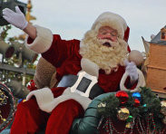 Santa Claus surrounded by gifts